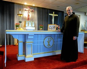 The Rev. Jason Kulczynski, Holy Martyrs pastor, stands by the altar used by Pope Francis during his visit to Philadelphia. Bob Raines--Montgomery Media